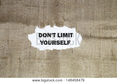 DON'T LIMIT YOURSELF written under torn paper