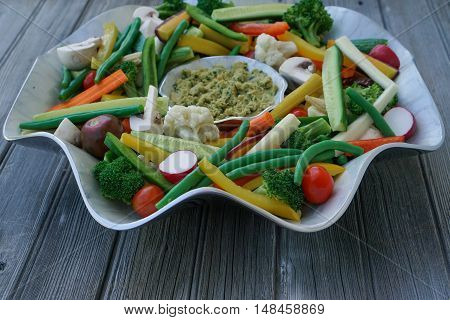 Vegetable Crudites and Dip/ vegetable platter on wood background, healthy eating, selective focus