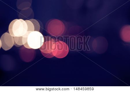 Abstract circular bokeh background of Christmaslight or carlights with cpyspace