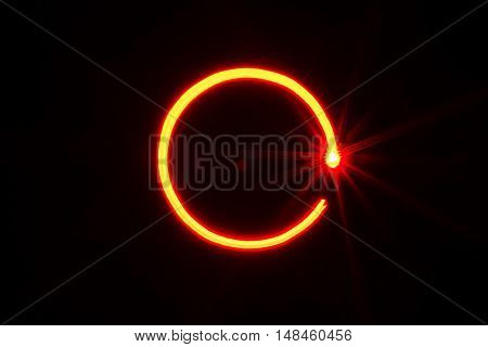 red light painting circle shape on black background