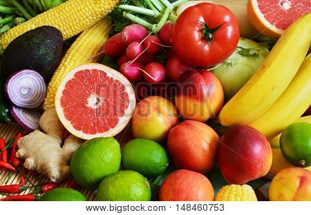 colorful vegetables and fruits with sliced grapefruit