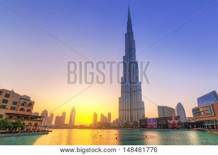 DUBAI, UAE - 1 APRIL 2014: Downtown of Dubai at sunset, UAE. Dubai is the most populous city in the United Arab Emirates with 2,1 million people.