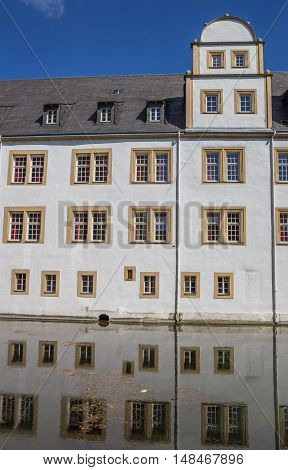 Neuhaus Castle Of Paderborn And Reflection In The Water