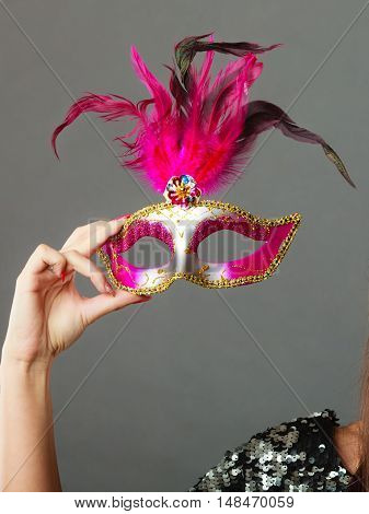 Woman Hand Holds Carnival Mask