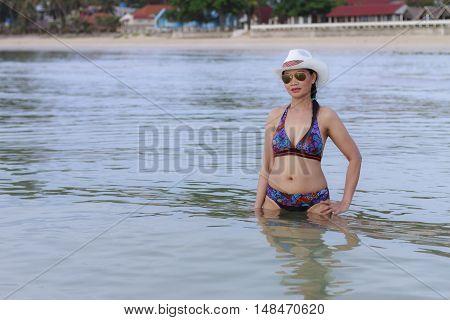 Women shape sexy relax on Thung Wua Lan Beach at Chumphon Provice Thailand
