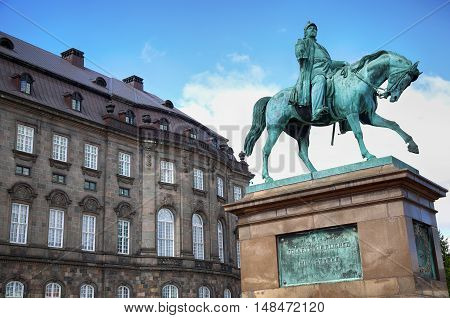 The equestrian statue of King Frederik VII in front of the Christiansborg Palace in Copenhagen Denmark