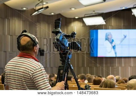 Moscow, Russia - September 2, 2016: Videographer makes online broadcast at the conference
