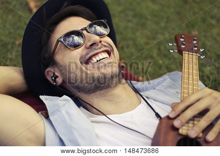 Smiling musician wearing sunglasses