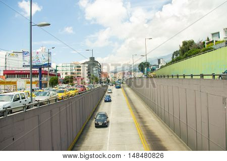 Trolley bus lane inner city Quito Ecuador on a sunny day with some random traffic.