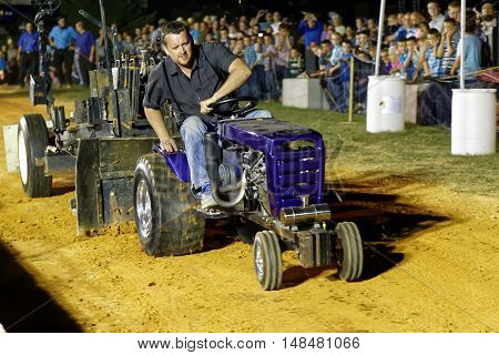 MYERSTOWN PENNSYLVANIA - SEPTEMBER 16 2016: A man drives a modified lawn tractor at Myerstown East End Days. The tractor pull is an annual community event.