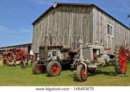 ROLLAG, MINNESOTA, Sept 1. 2016: Restored Twin City, Farmall, and Case tractor are displayed at the West Central Steam Threshers Reunion in Rollag, MN attended by 1000's held annually on Labor Day weekend.