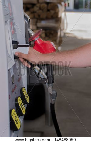 Using credit card at the gas pump with rising prices of gas, at the fuel station