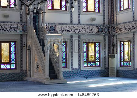 TURKEY ALANYA - NOVEMBER 10 2013: The interior and minbar in a Kuyularonu Mosque in Alanya. The mosque was built in 2005 and has a library for foreign tourists.