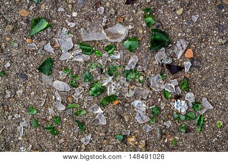 Broken glass, shattered, broken glass pieces, glass debris, cracked glass, broken bottles, asphalt