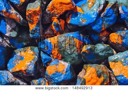 Bright abstract background. Stones painted with paint close