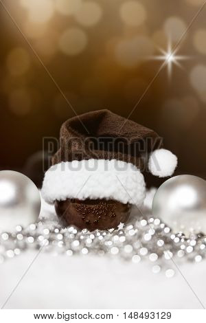Christmas Balls, Pointed Hat And Pearls, Festive Brown Background With Stars