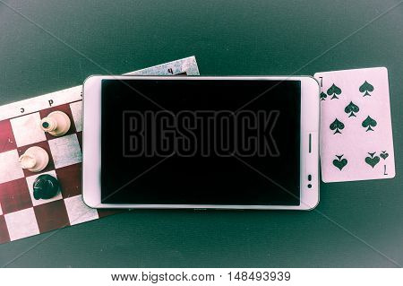 Various board games with tablet pc. Background for mobile for gaming and gambling.