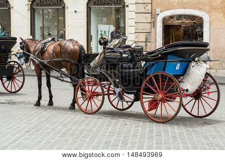 ROME ITALY - JUNE 15 2015: Horse Cabs Waiting for customers on the Piazza di Spagna. Rome. Italy
