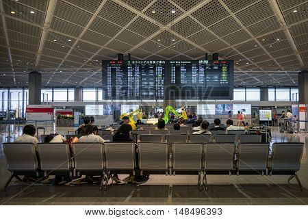 TOKYO, JAPAN - circa JUNE 2016: Passengers at terminal 2 departure area at Narita International Airport, Tokyo, Japan. Narita Airport, also known as Tokyo Narita Airport, is an international airport serving the Greater Tokyo Area of Japan.