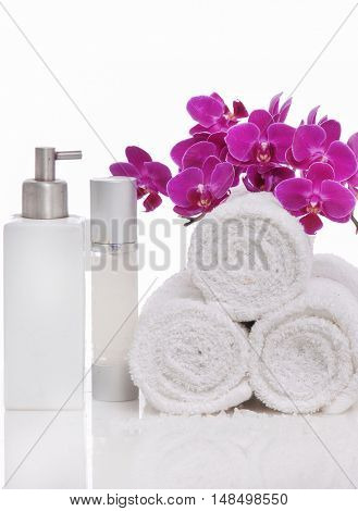 Spa still life with bottle of herbal essenses