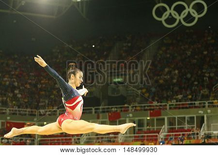 RIO DE JANEIRO, BRAZIL - AUGUST 9, 2016: Olympic champion Aly Raisman of United States competes on the balance beam at women's team all-around gymnastics at Rio 2016 Olympic Games at Rio Olympic Arena
