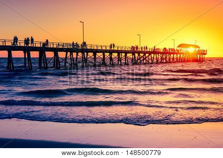 Henley Beach Jetty on a warm sunny evening. Color-toning effect applied