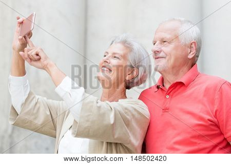 Smiling senior couple make a selfie