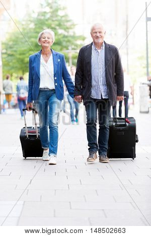 Senior couple with  suitcases