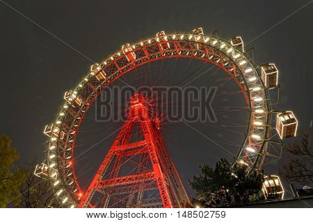 VIENNA AUSTRIA - NOVEMBER 23 2013: Wiener Riesenrad in Prater Park at night. Giant Ferris Wheel (64.75-meter tall) is one of the best attractions of the city.
