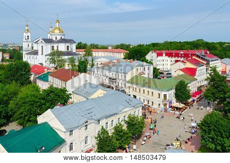 VITEBSK BELARUS - JULY 13 2016: Top view of Suvorov Street and Holy Assumption Cathedral. Street trade during annual popular music festival Slavic Bazaar