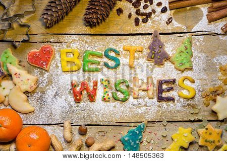 Christmas Decoration And Cookie Letters On Wooden Table, Best Wishes