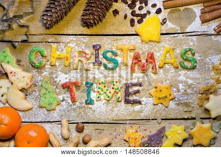 Biscuit Letters And Christmas Decoration On Wood, Christmastime