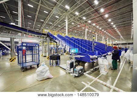 RUSSIA, MOSCOW - DEC 16, 2014: Women separate parcels in the automated sorting center in Vnukovo. Moscow Automated sorting center - the largest in Eastern Europe.