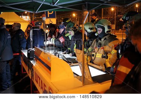 RUSSIA, MOSCOW - FEB 26, 2015: Many firefighters in uniform are standing near headquarter at Preobrazhenskaya ploshchad subway.