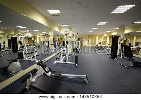 RUSSIA, MOSCOW - 10 DEC, 2014: Light big gym with many equipment for bodybuilding at the rehabilitation center.