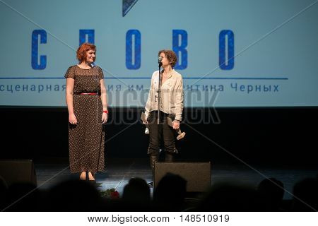 RUSSIA, MOSCOW - APR 14, 2015: Two women is performing on the stage at Scenary Awards Chernykh (Slovo).