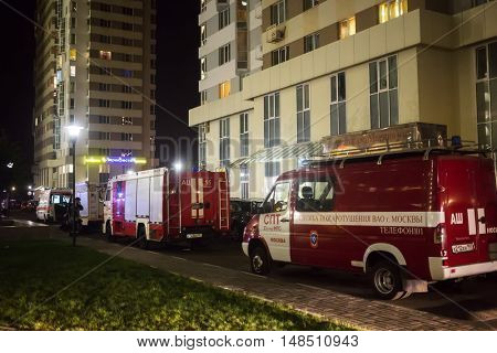 RUSSIA, MOSCOW - AUG 25, 2015: Firefighters extinguish fire in housing complex Elk island.
