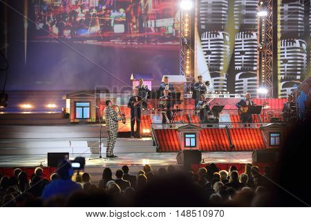 RUSSIA, MOSCOW - DEC 17, 2014: Saxophonist with orchestra at Annual Award Ceremony Federation of Jewish Communities of Russia Violinist on the Roof 5774 in State Kremlin Palace