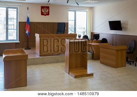 MOSCOW, RUSSIA - JUL 1, 2015: Court of law hall with wooden furniture, flag and screen on the wall.