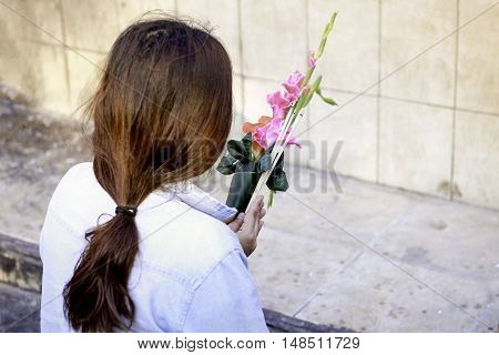 woman pray for her life with flower in hand