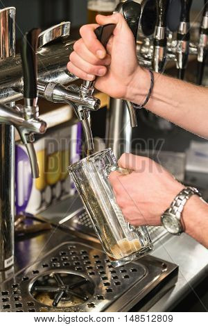 Draught beer in bar, toned image, vertical image
