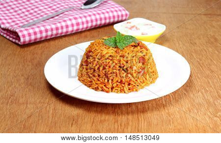 Indian homemade traditional food rice pilaf on a plate.