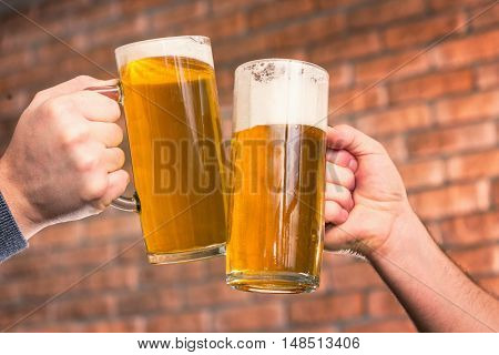 Beer toast in bar, toned image, horizontal