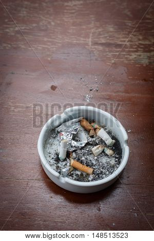 Cigarette Stub In Ashtray, Image No Smoking Concept Background
