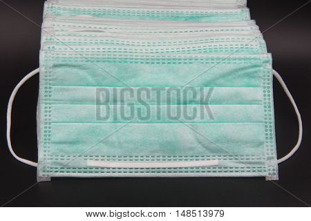 Disposable face mask , mask Medical shielding on black background