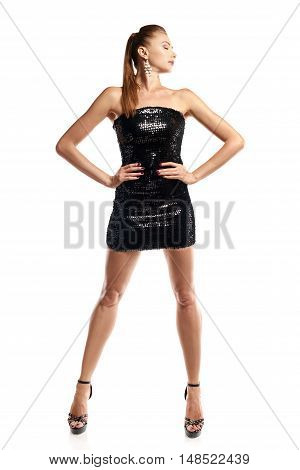 Full length portrait of young gorgeous woman in black sequined mini dress