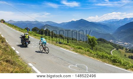 Col D'AspinFrance- July 152015: The Ukarainian cyclist Andriy Grivko of Astana Team climbing the road to Col D'Aspin in Pyrenees Mountains during the stage 11 of Le Tour de France 2015.