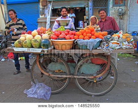 Group Of People Are Selling Fruits Outdoor