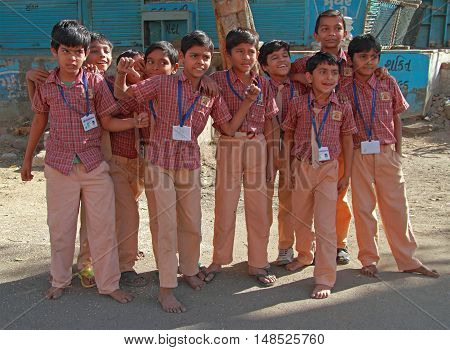 School Children Dressed In Uniform Go Home After Classes In Ahmedabad, India