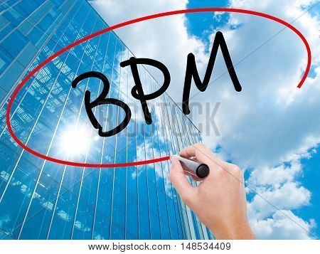 Man Hand Writing  Bpm (business Process Management) With Black Marker On Visual Screen